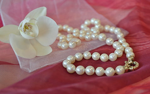 white pearl beaded necklace and white petal flower