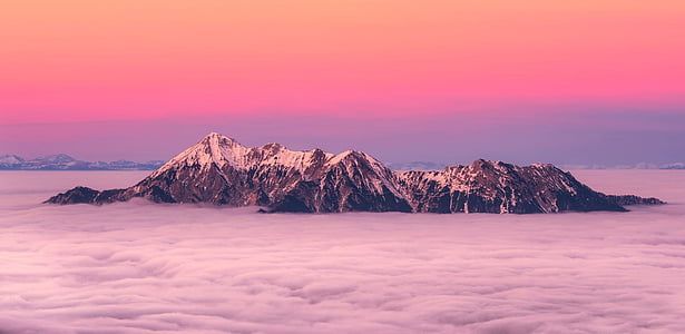 photo of snowy mountain during sunset