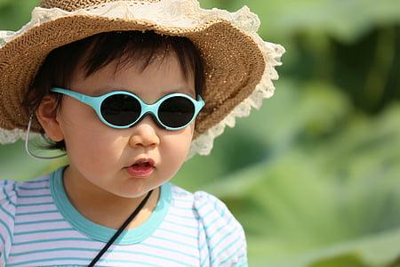 girl wearing stripe shirt, sunglasses selected photograghpy