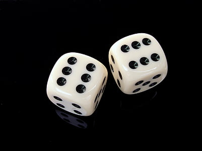 two white-and-black dice cubes