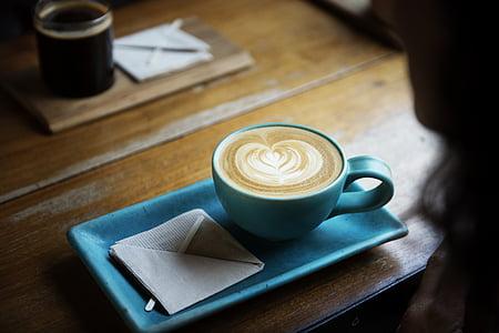 cappuccino in blue ceramic cup