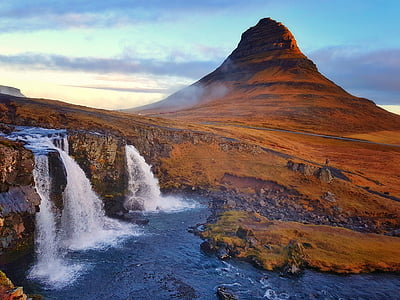 landscape photography of mountain with waterfalls