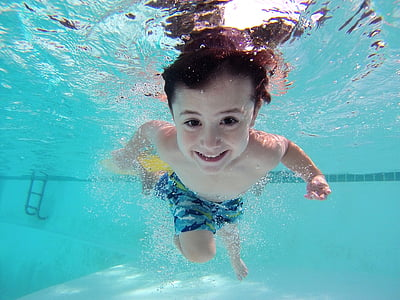 boy swimming on swimming pool