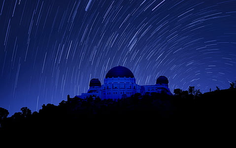 long exposure photography of mosque at night with stars