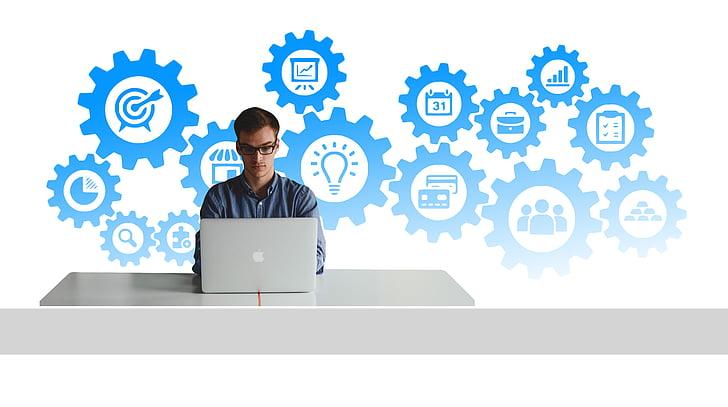 man using laptop with bright ideas illustration