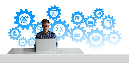 man using laptop with bright ideas illustration