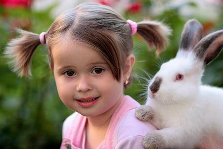 toddler girl wearing pink shirt and white rabbit