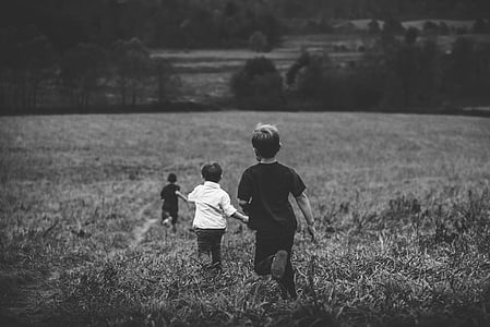 three running children in field