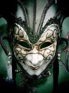 white, gray, and black opera mask