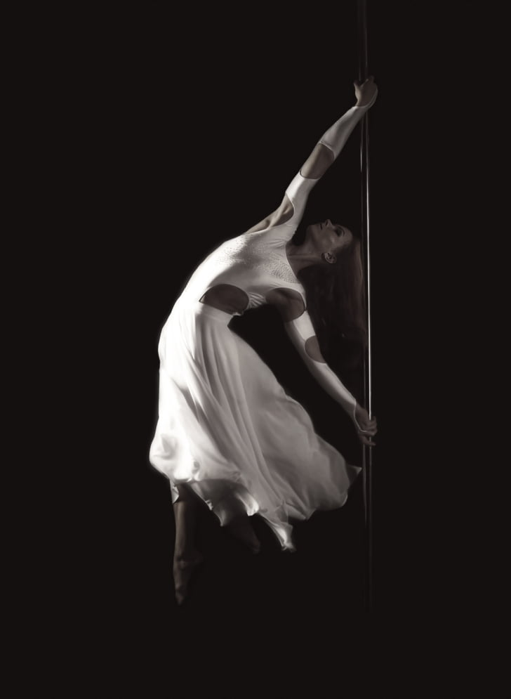 grayscale photography of woman pole dancing