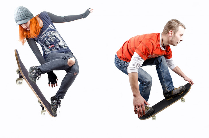 two person performing tricks on skateboards