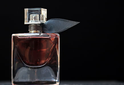 fragrance spray bottle with black background