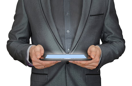 person holding black tablet