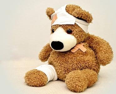 brown injured bear plush toy
