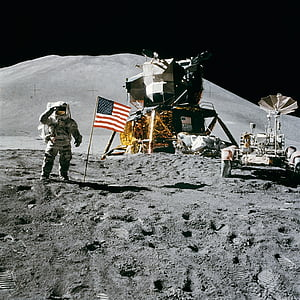 astronaut near American flag and space ship