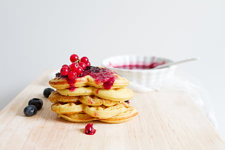 pancake on brown wooden surface