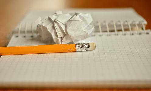 bitten pencil head on graphing paper notebok