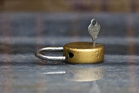 gold padlock with key photograph