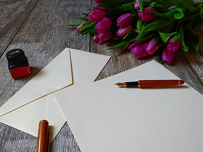 white envelope paper with ballpoint pen