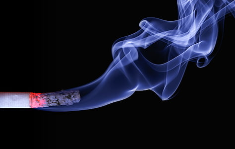 white smoke on lighted cigarette stick