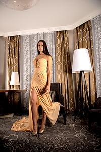 woman wearing long dress inside room