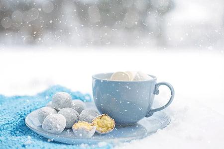 closeup photo of blue ceramic tea cup