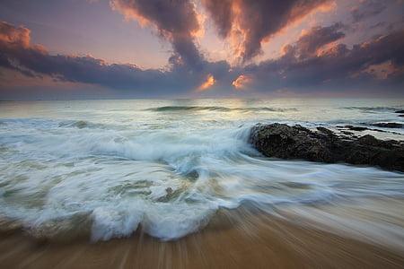timelapse photo of shoreline during golden hour