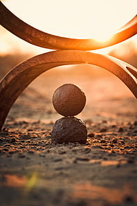round stone and view of sunset