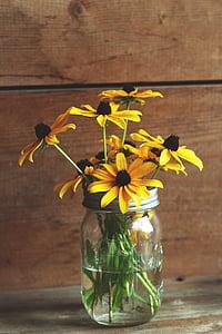 yellow flowers on vase