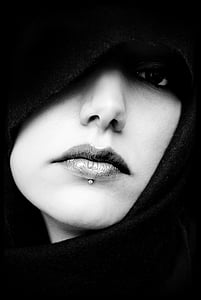 grayscale photo of woman wearing black scarf