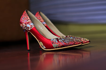 pair of red-and-white pointed-toe stilettos