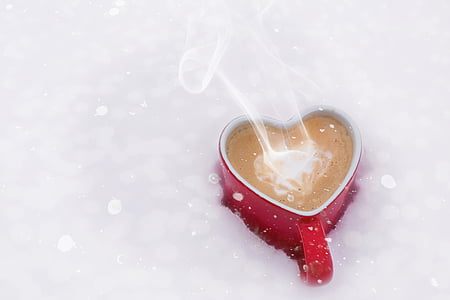 heart-shaped red ceramic mug