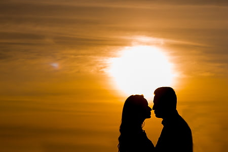 silhouette of man and woman facing each other