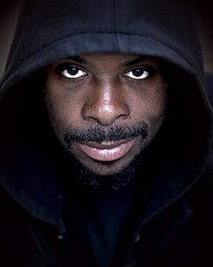 man wears black hoodie