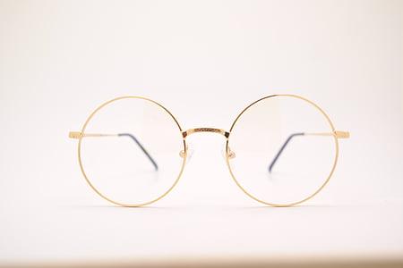 round gold-colored framed eyeglasses