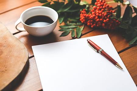 brown click pen on white printer paper