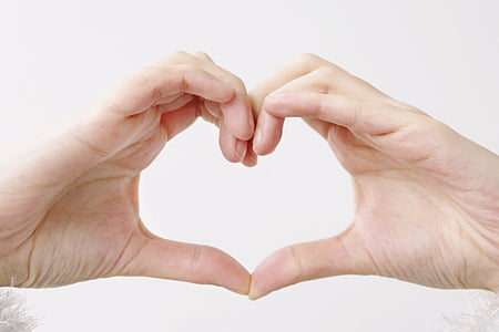 person doing heart gesture