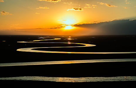 landscape photography of snake like river under golden hour