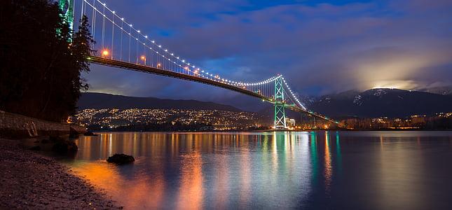 lighted concrete bridge at nighttime