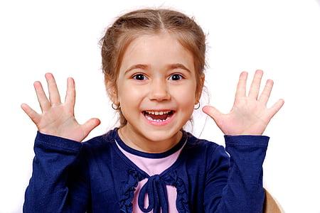 girl in blue long-sleeved shirt