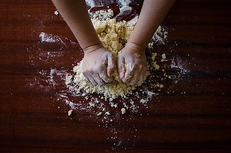 person holding flour photo