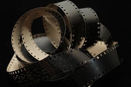 closeup photo of white and black camera film