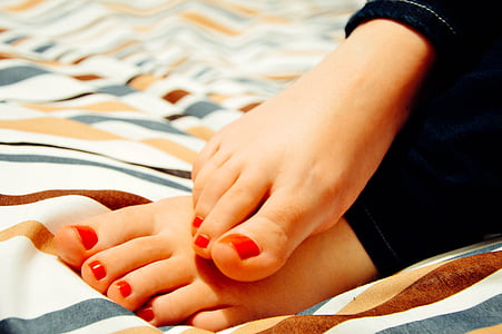 woman with red pedicure
