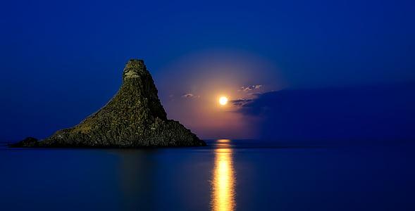 mountain horizon during night time