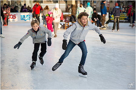 two boys playing ice skates