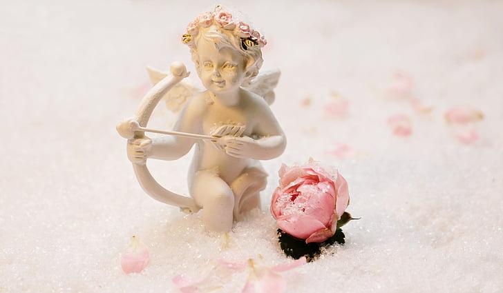 cupid beside rose bud