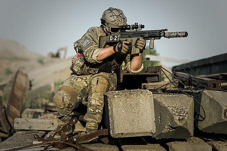 army holding gun during daytime