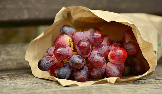 grape fruits in brown paper bag