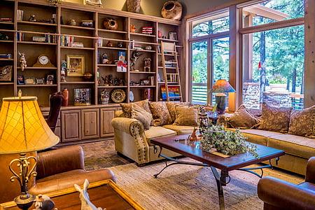 brown sofa near window