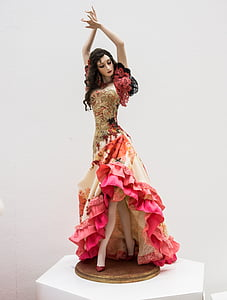 woman in red and brown floral ruffle dress figurine
